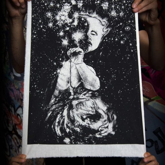 Starseeker Screenprint Back Patch held by hand
