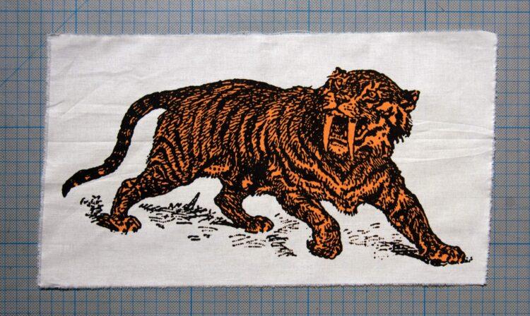 Sabre Tooth Tiger Orange Screenprint Back Patch on cm background