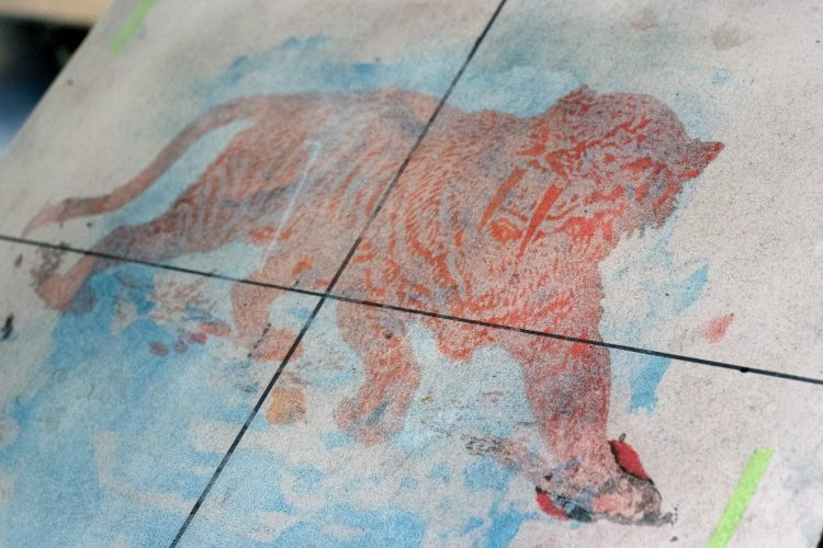 Ghost image of Sabre Tooth Tiger print on printing table